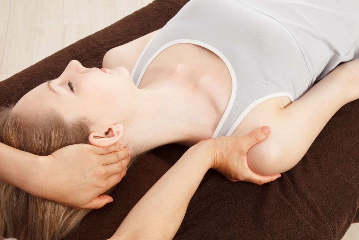 Young woman undergoing a massage as part of physical therapy